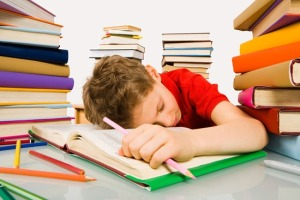 Kid-Asleep-with-Textbook