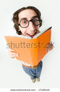 stock-photo-portrait-of-smiling-male-in-glasses-reading-interesting-book-17438440