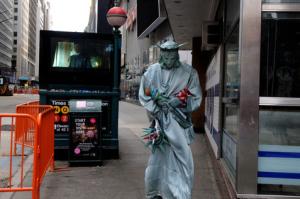 Times-Square-Huddled-Masses2014-02-02-at-4.14.28-PM