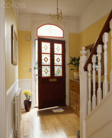Hallway with front door ajar
