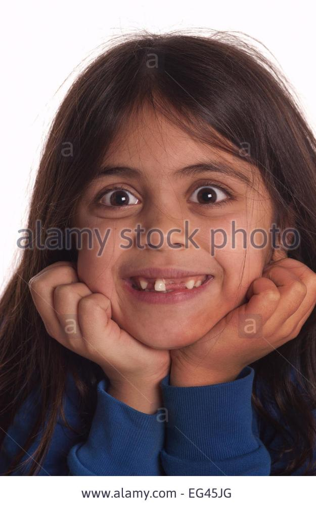 seven-year-old-girl-happy-growing-up-and-fact-about-to-loose-last-EG45JG (1).jpg